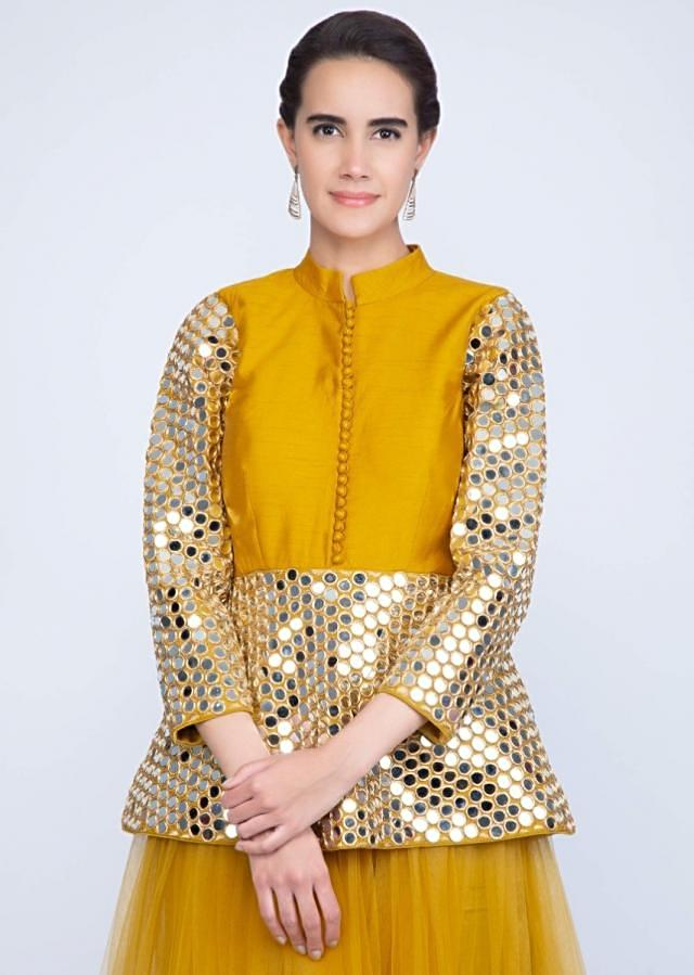 Mustard yellow net lehenga with mirror embroidered peplum blouse only on Kalki