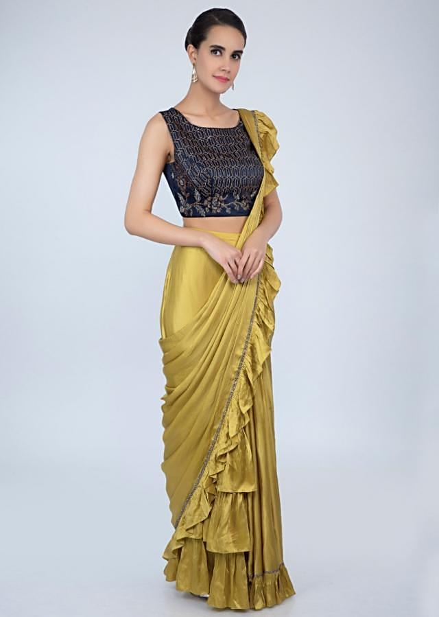 Pine yellow ready pleated satin saree with frilled hem and pallo only on Kalki