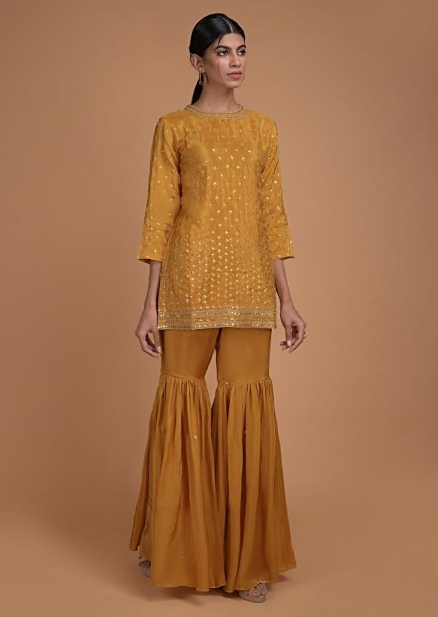 Mustard Yellow Sharara Suit In Satin Crepe With Short Kurti And Sequins Embroidered Buttis Online - Kalki Fashion