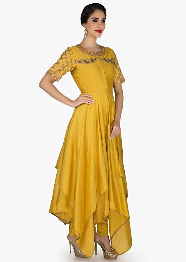 Mustard A line suit in cotton silk with handkerchief hem line only on Kalki