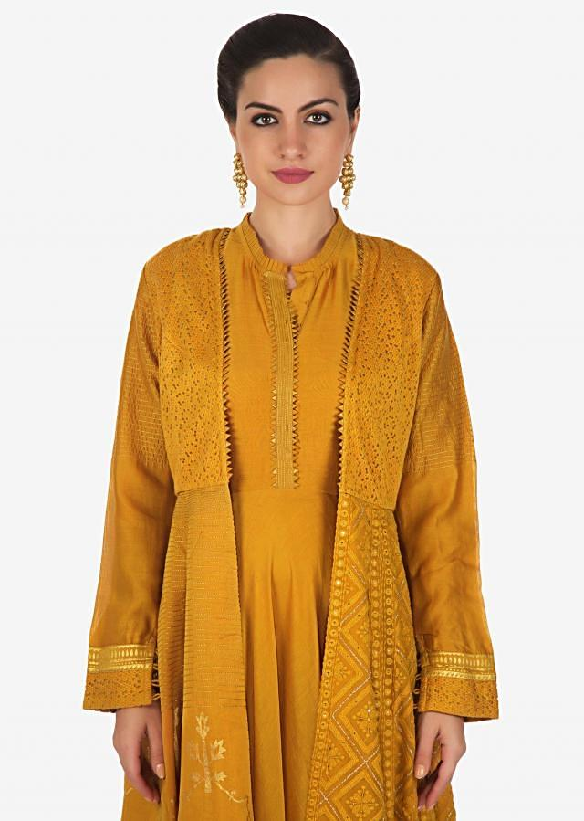 Mustard anarkali suit matched with jacket in thread and foil print only on Kalki