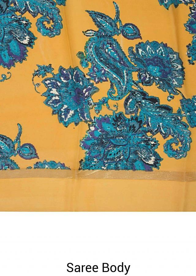 Mustard and blue saree in georgette with big floral print only on Kalki
