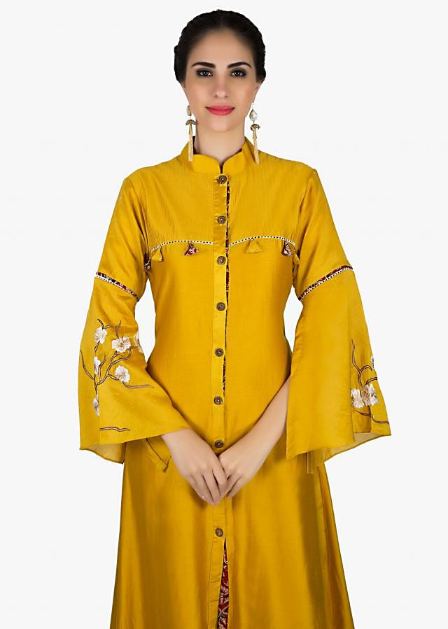 Mustard asymmetric kurti in fancy hem and wooded buttons only on Kalki
