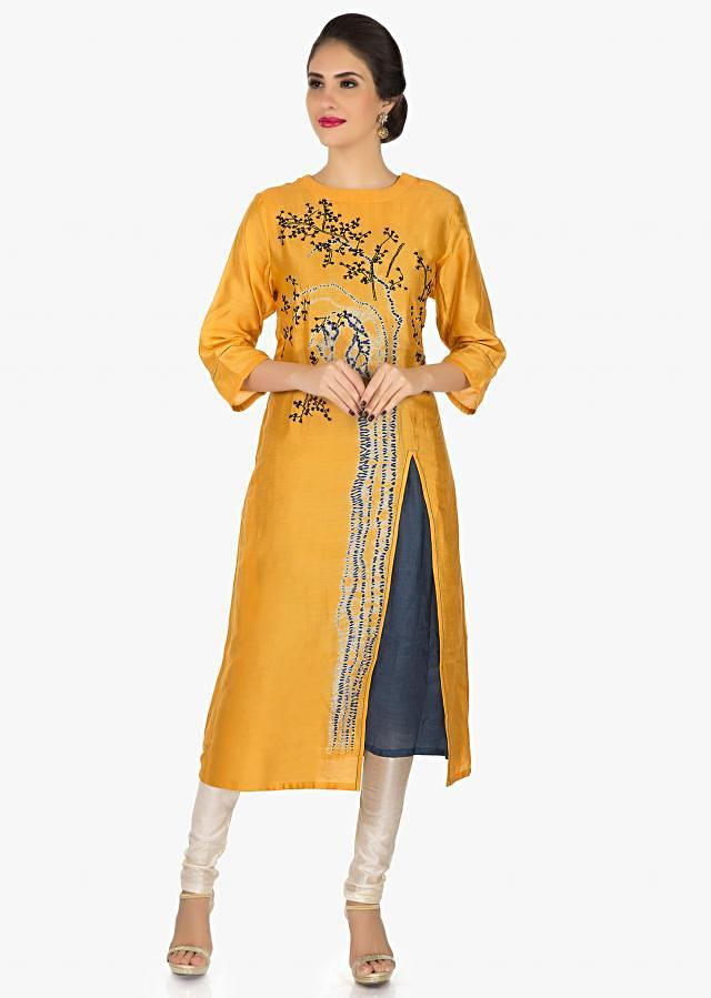 Mustard cotton kurti featuring the thread work and bandhani print only on Kalki