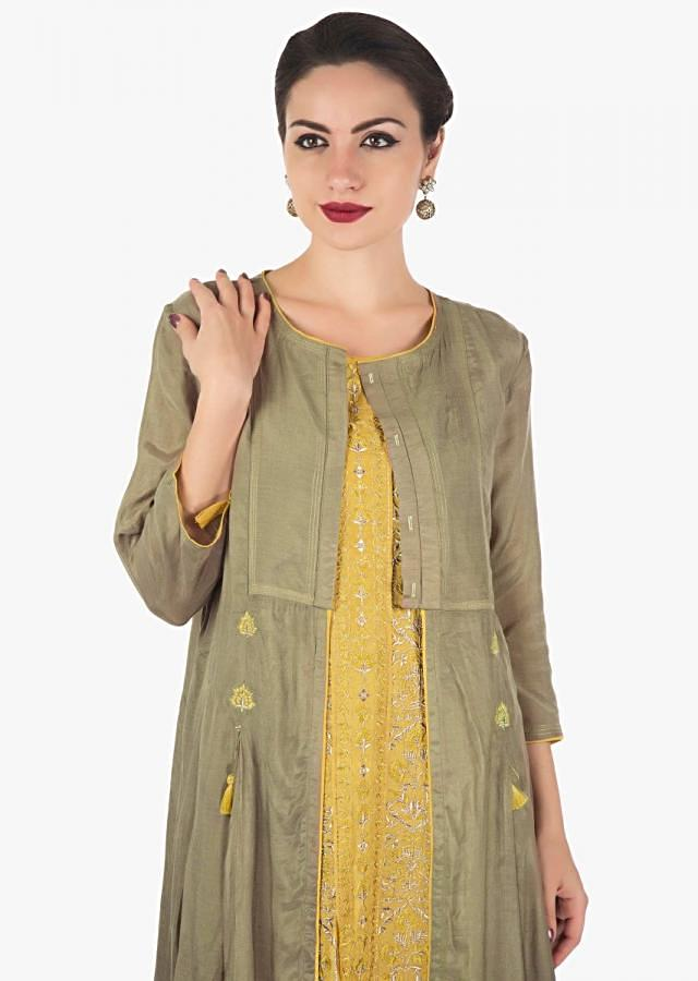 Mustard dress featuring in cotton with resham and zari embroidery with attach jacket only on Kalki