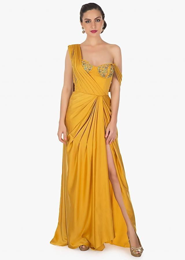 Mustard gown with corset embroidered bodice and high slit only on Kalki