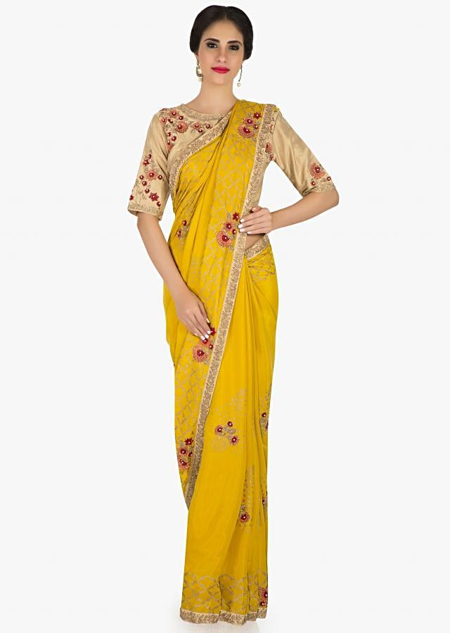 Mustard saree in cotton with beige blouse featuring the french knot and zari work only on Kalki