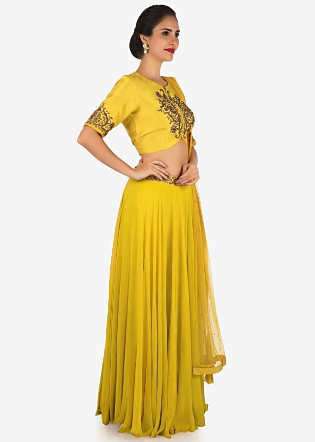 Mustard skirt and crop top carved with zardosi embroidery work only on Kalki