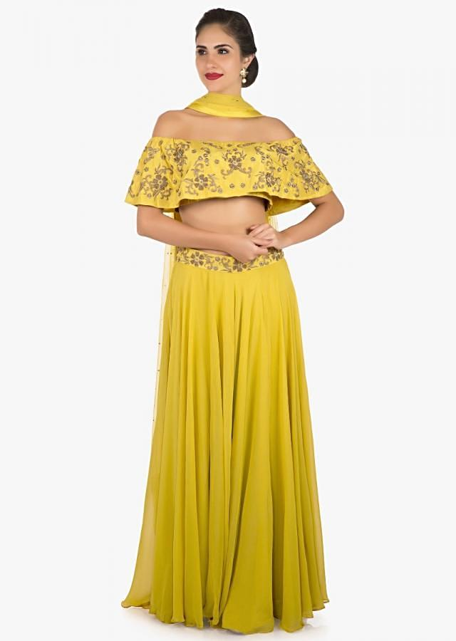 Mustard skirt and off shoulder crop top carved with zardosi embroidery work only on Kalki