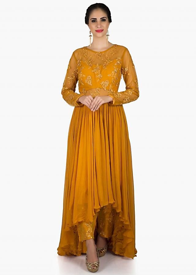 Mustard suit in georgette in embroidered bodice  with silk pants only on Kalki