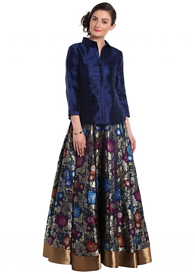 Navy blue brocade skirt in floral motif with silk blouse only on Kalki