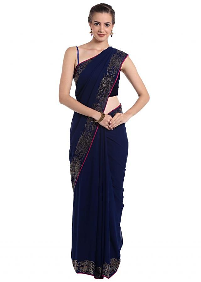 Navy blue georgette saree designed with a kundan border only on Kalki