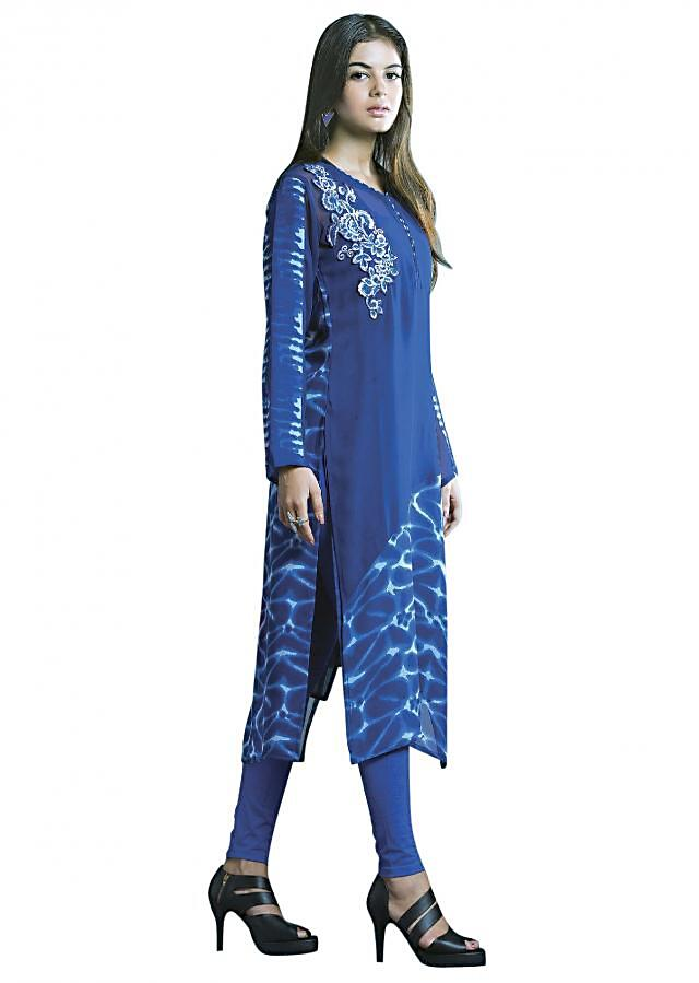 Navy blue kurti featuring in georgette. Its enhanced in resham applique embroidery along with printed hem line.
