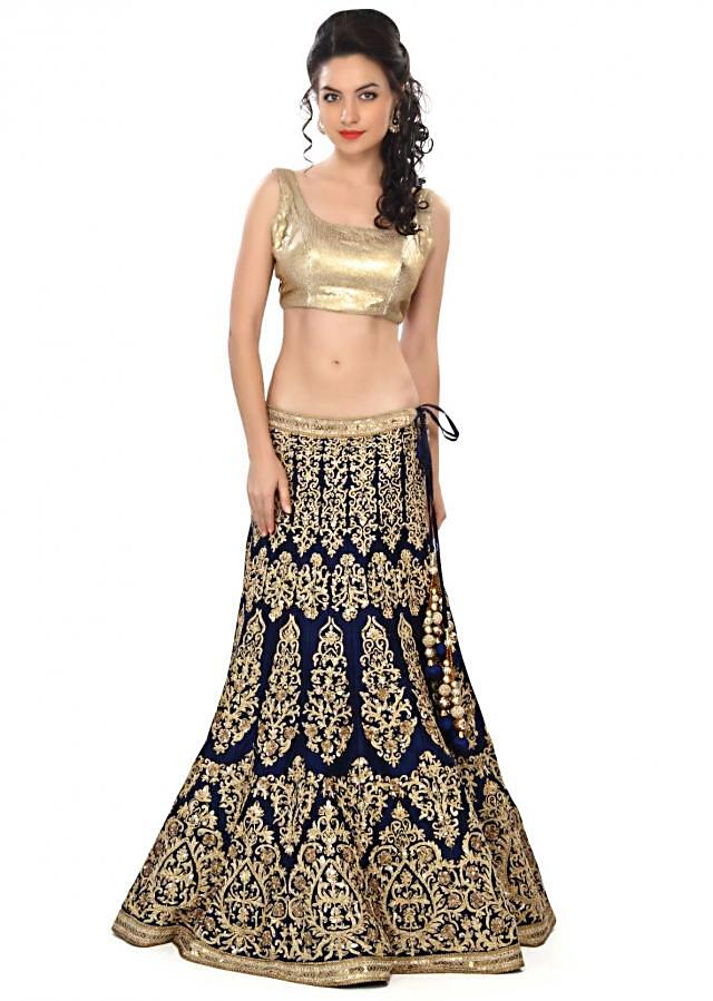 Navy blue lehenga featuring in zari and sequin embroidery only on Kalki