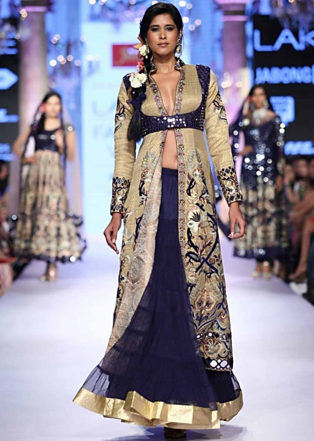 Model in navy blue lehenga with cream embroidered long jacket walks the ramp for Suneet Verma for his collection Decorative Arts of India at Lakme Fashion Week Summer Resort 2015