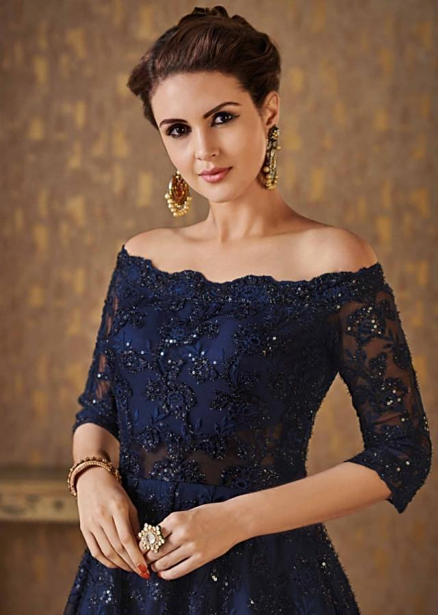 Navy blue off shoulder gown adorn in embossed thread and sequin embroidery