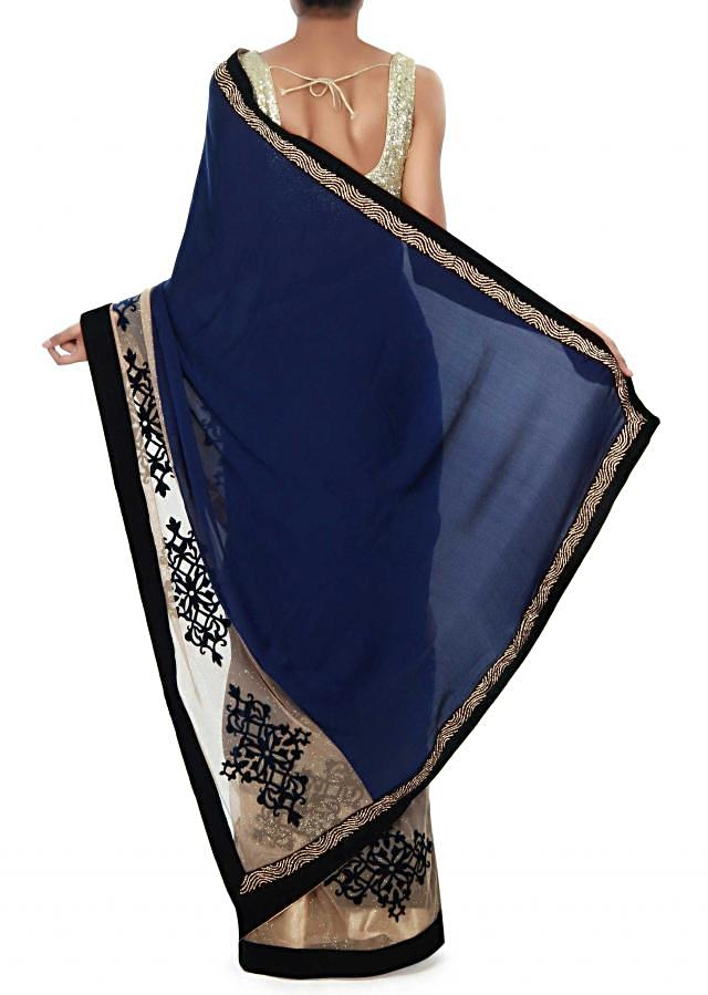 Navy blue saree enhanced in applique embroidery only on Kalki