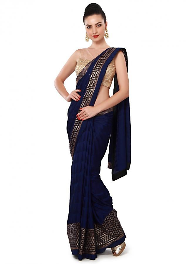 Navy blue saree features with sequin embellished border only on Kalki