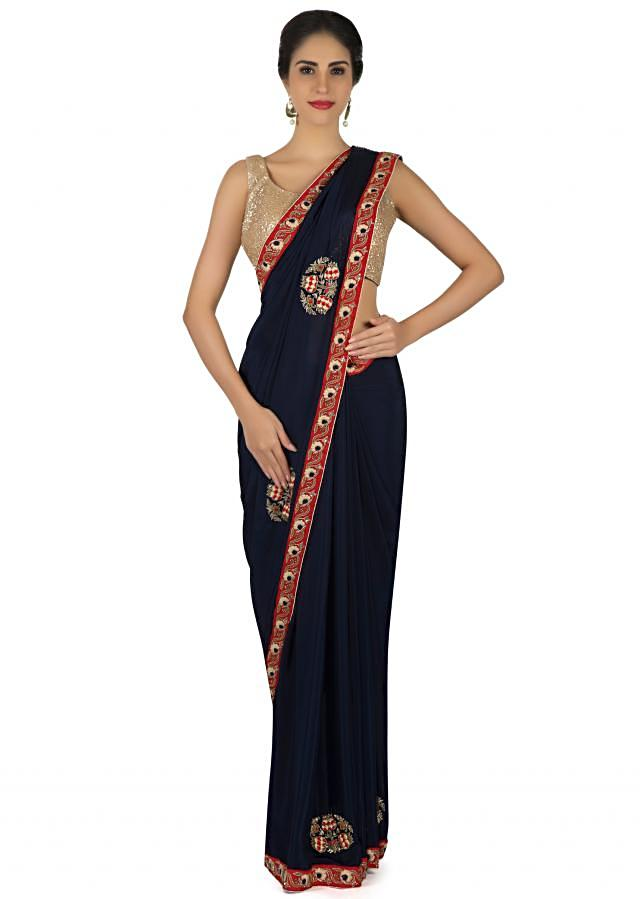 Navy blue saree in satin chiffon in resham and thread embroidered butti only on Kalki