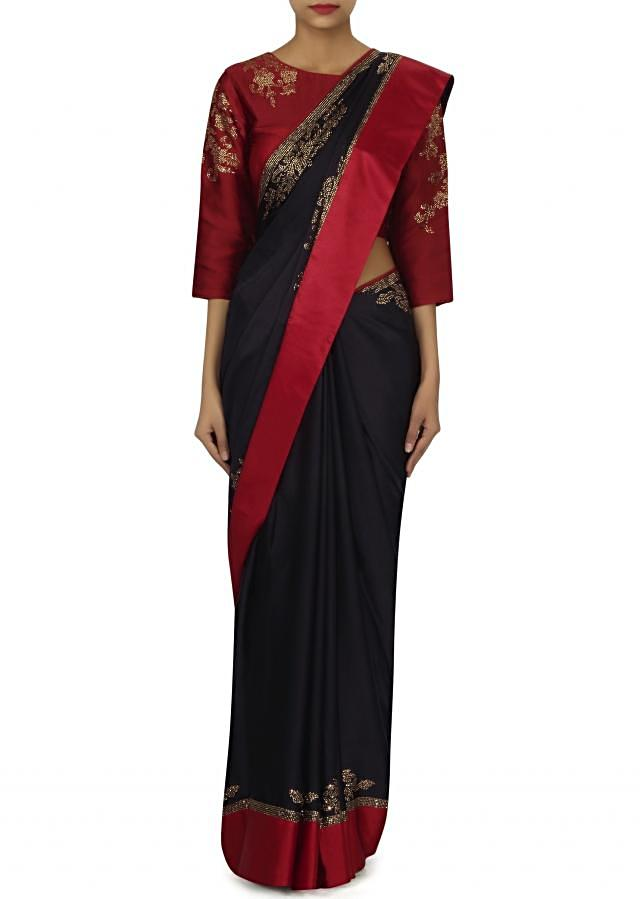 Navy blue saree with red embroidered stitched blouse only on Kalki