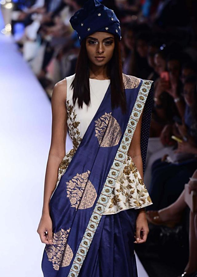 Model walks the ramp in navy blue saree with white long embroidered jacket blouse for SVA collection named Istanbul at Lakme Fashion Week Summer Resort 2015