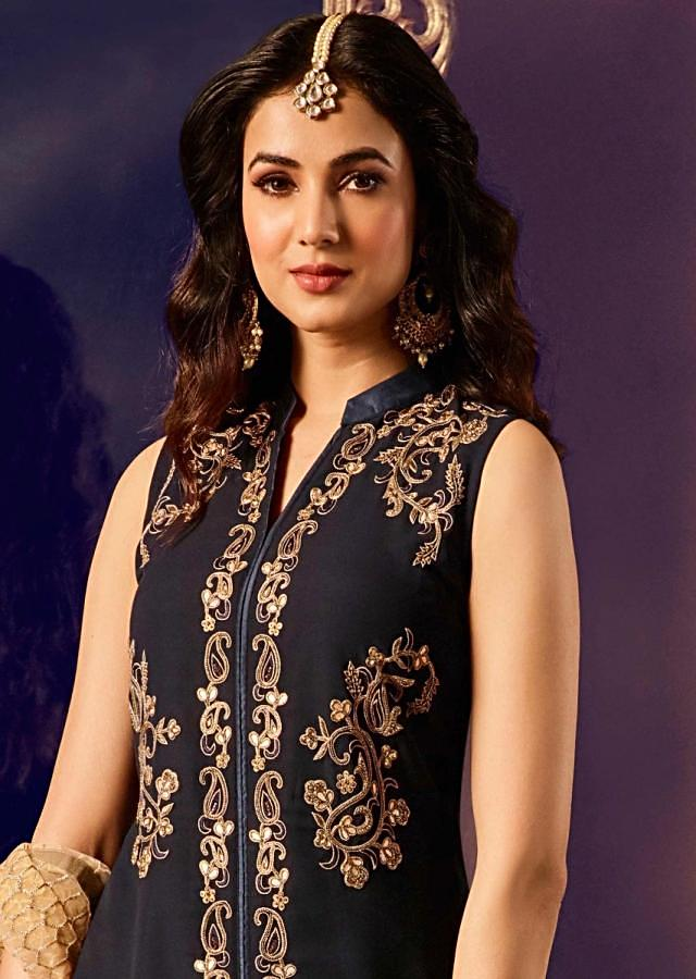 Navy blue suit in georgette with gotta patch and moti work in paisley motif