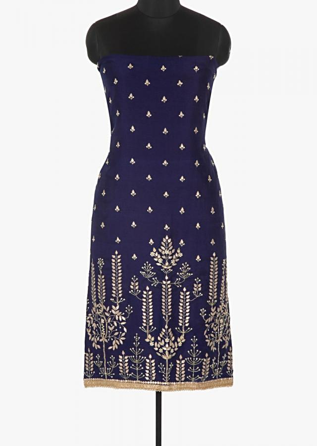 Navy blue unstitched suit featured in silk intricated with gotta patch and moti work only on Kalki