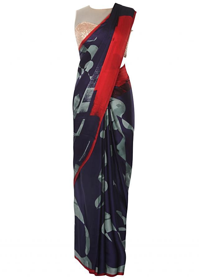 Navy blue abstract printed saree with contrast red border only on Kalki