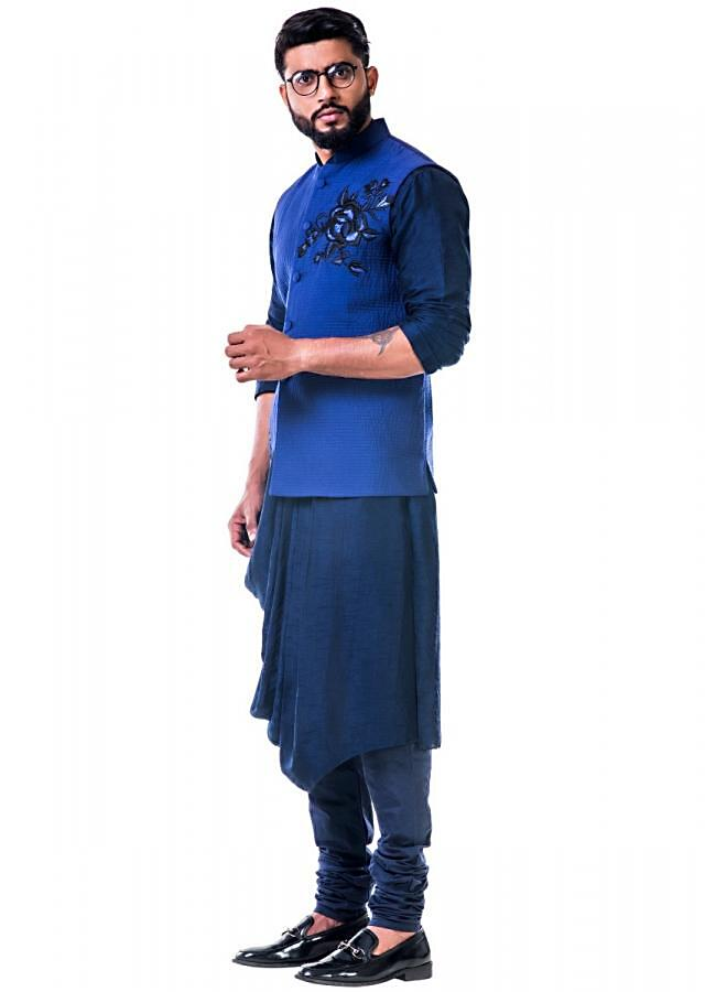 Navy blue cowl kurta set with loop buttons and a blue quilted jacket with thread work embroidery only on Kalki