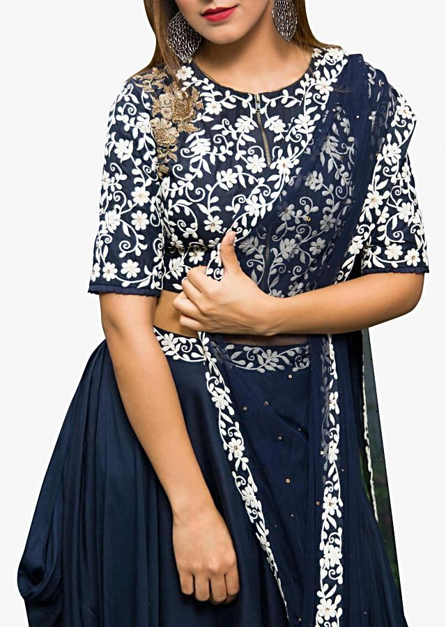 Navy blue lehenga in georgette with embossed thread embroidered blouse