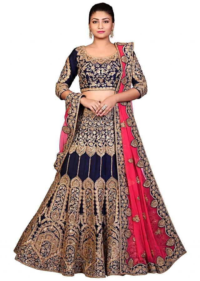 Navy blue lehenga in raw silk with stitched blouse and contrast dupatta only on Kalki