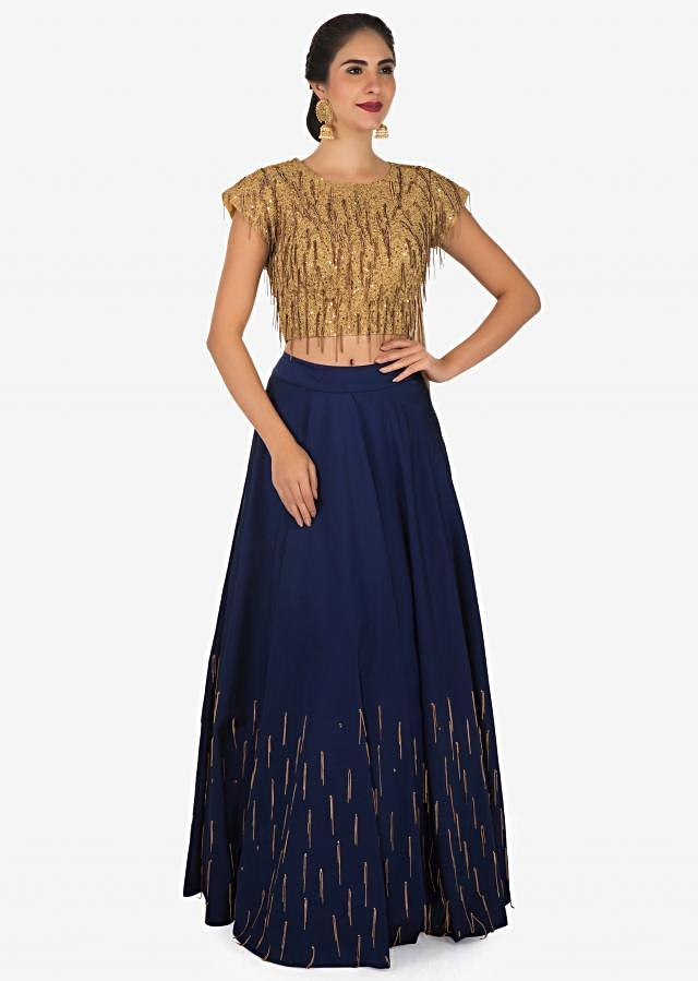 Navy blue lehenga in silk with gold fancy blouse enhanced in tassel only on Kalki