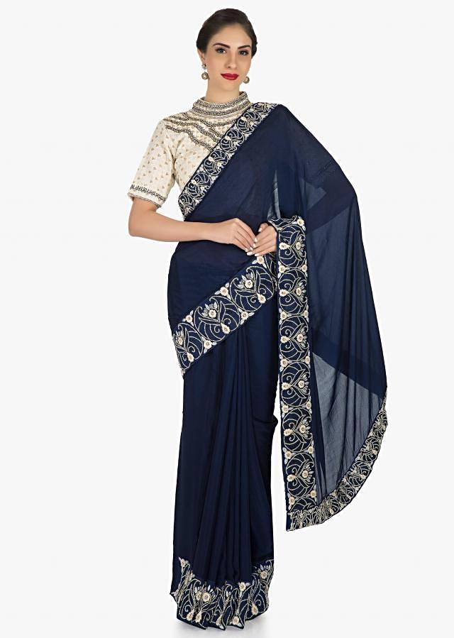 Navy Blue saree in georgette adorn in resham and cut dana embroidery work only on Kalki