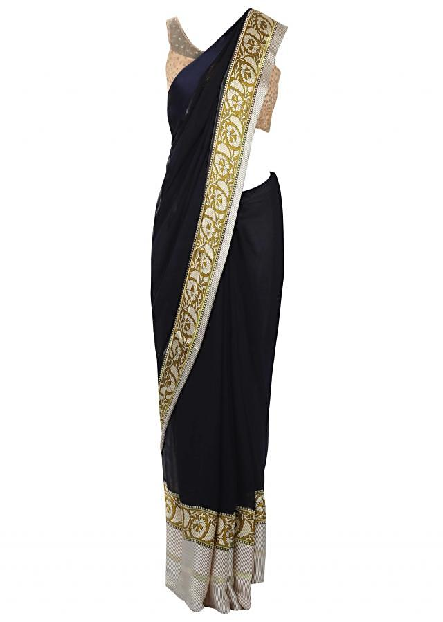 Navy blue saree in georgette with floral lace border only on Kalki