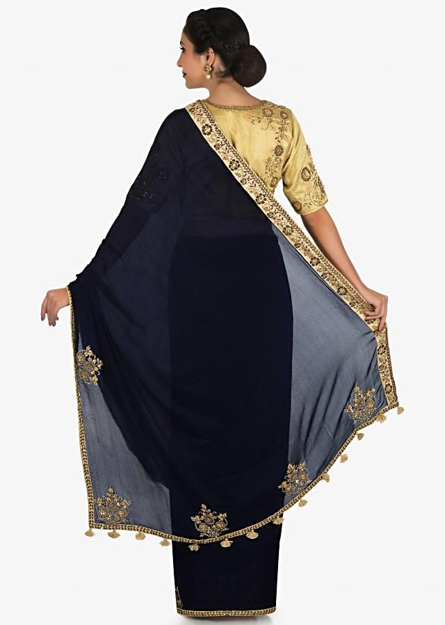 Navy blue saree in satin silk with a beige blouse embroidered with zardosi and sequin work only on Kalki