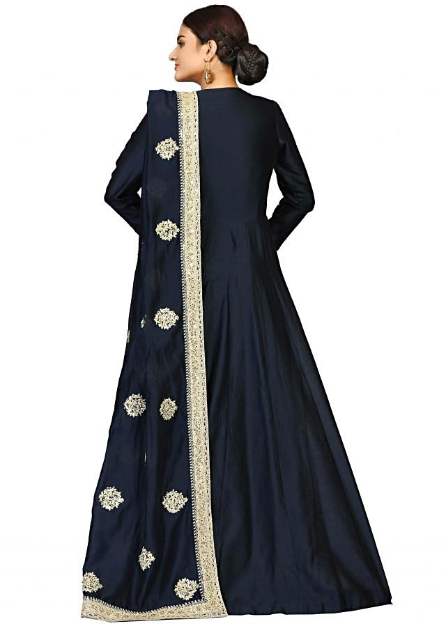 Navy blue suit in chanderi featuring the flawless zari and sequin work only on Kalki