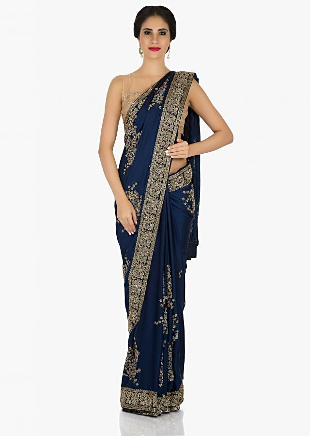 Navy saree in satin flaunting the french knot and sequin embroidery only on Kalki