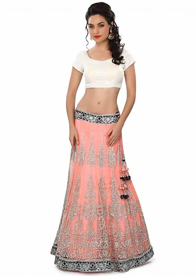 Neon pink lehenga embellished in stone and kundan embroidery only on Kalki