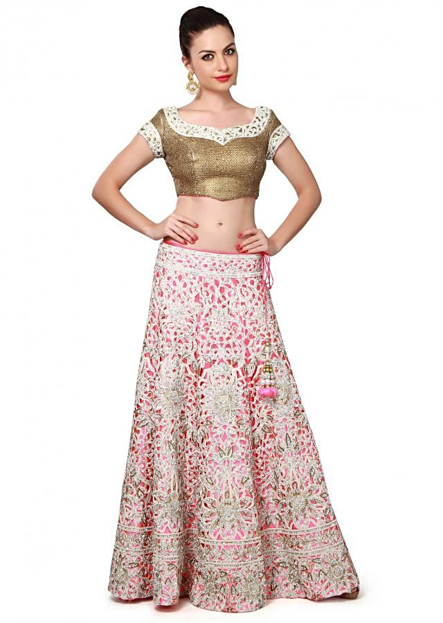 Neon pink lehenga enhanced in cut work embroidery only on Kalki