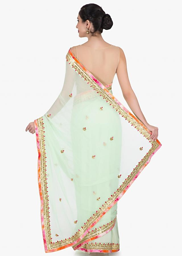 Light green saree in georgette beautified in gotapatti embroidery work only on Kalki
