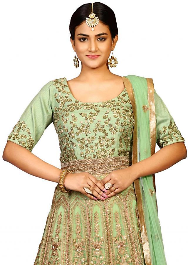 New anarkali suit in raw silk showcasing the sparkling ari kali embroidery only on Kalki