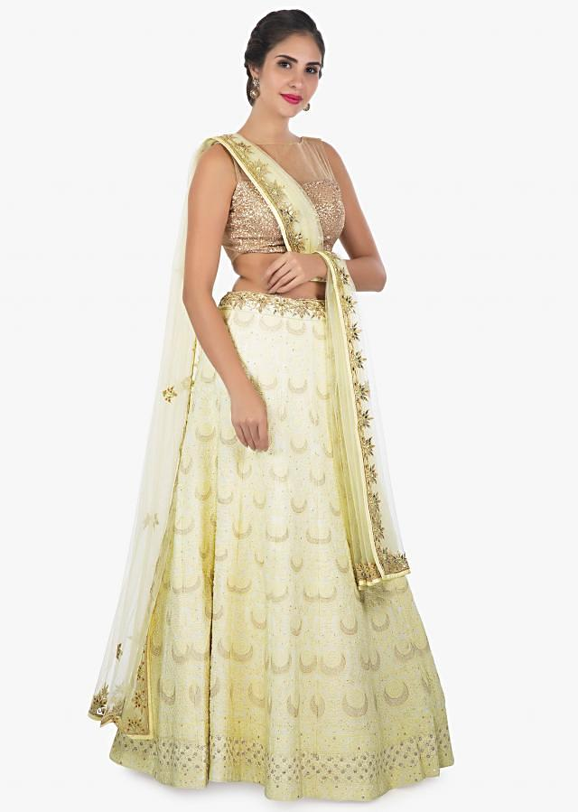 Nog yellow lehenga with thread work all over and a net dupatta with gotta patch only on Kalki
