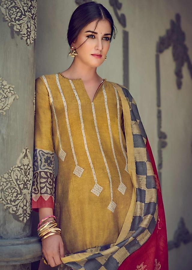 Ochre Suit In Tussar Silk With Batik Print In Geometric And Floral Pattern On The Hemline Online - Kalki Fashions
