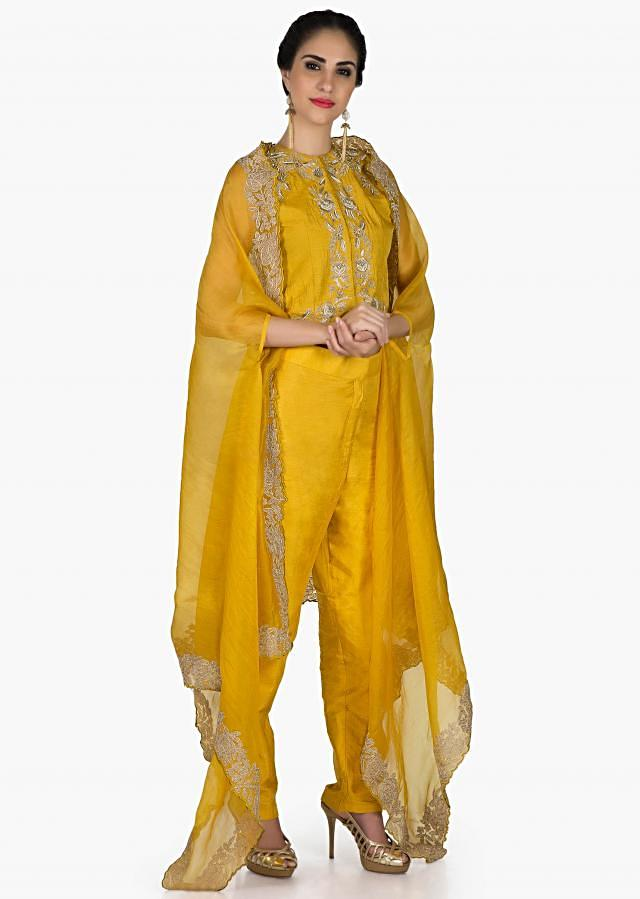 Ochre Yellow suit in silk with french knot embroidered and fancy jacket in silk only on Kalki