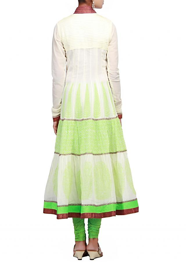Off white anarkali suit highlighted in pleats and print