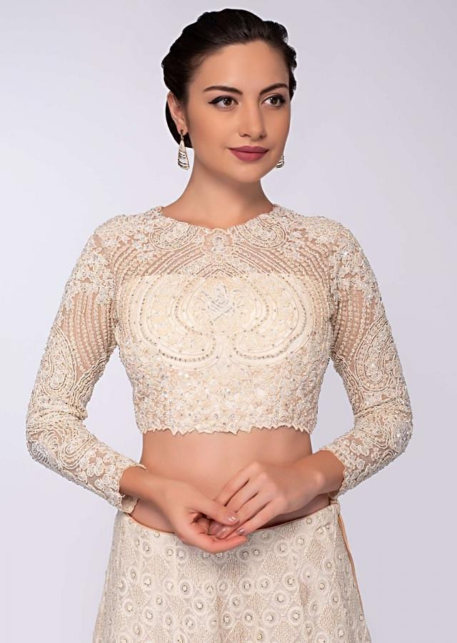 Shiny Doshi in Kalki off white and peach shade lehenga set in thread embroidery
