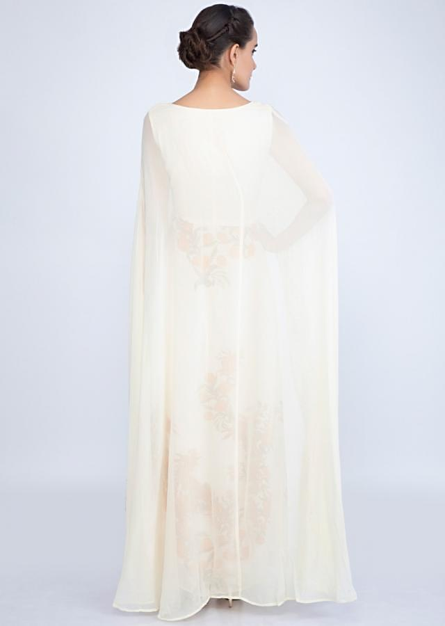 Off white cape tunic dress with contrasting contrasting flroal print only on kalki