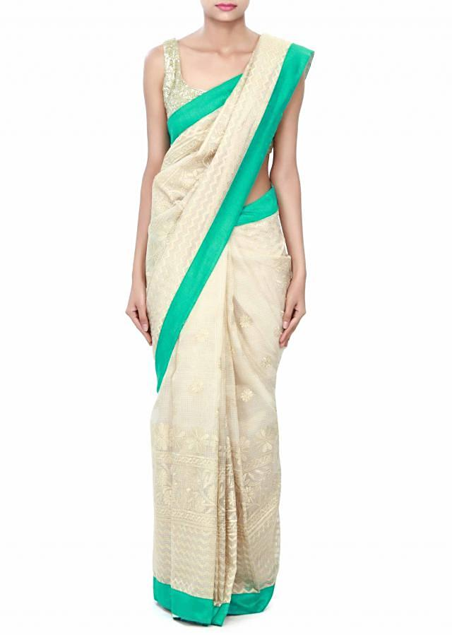 Off white chanderi silk saree embellished in thread embroidery only on Kalki