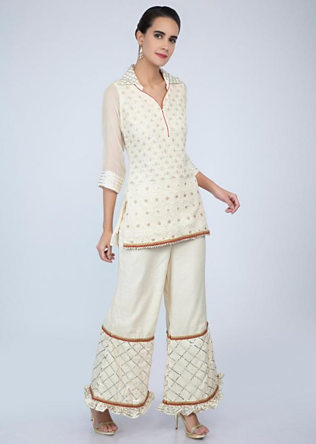Off white chicken embroidered suit in mandarin collar with lace embroidered sharara only on Kalki