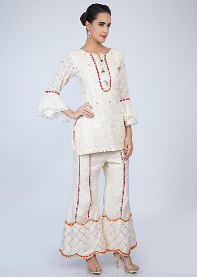 Off white chicken embroidered suit with lace embroidered palazzo only on Kalki